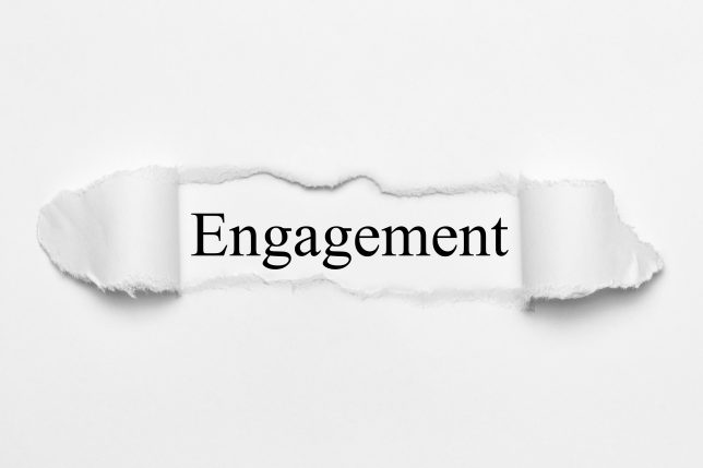 Engagement on white torn paper